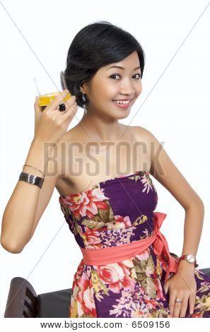 Beautiful Woman Drinking Orange Juice While Sitting