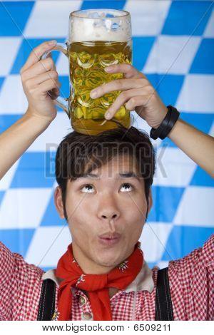 Asian Man Having Oktoberfest Beer Stein  Head And Looks Surprised