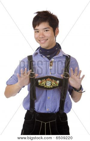 Young handsome happy Man In Bavarian Oktoberfest Leather Trousers (lederhose)