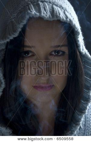 Woman With Hood In Smoke
