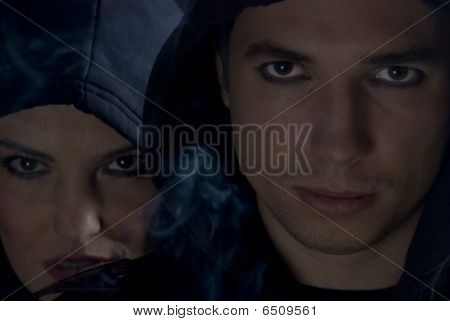 Young People In Dark With Smoke