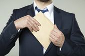 pic of bribery  - young businessman in a suit - JPG