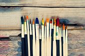 pic of bristle brush  - Photo of paint brushes on wooden background - JPG