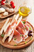 picture of antipasto  - prosciutto ham and grissini bread sticks - JPG
