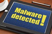 pic of malware  - malware detected alert on a digital tablet with a cup of tea - JPG
