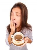 picture of yawn  - Tired woman yawning spilled a little coffe - JPG