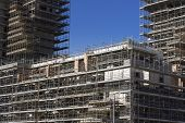 stock photo of scaffold  - Scaffolding on a construction site of a new building - JPG