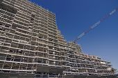 picture of scaffolding  - Scaffolding on a construction site of a new building - JPG