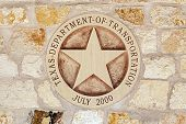 stock photo of texas star  - Texas Department of Transportation Symbol on the Sandstone Wall - JPG