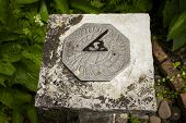 pic of sundial  - A stone sundial in Dunster Park, devon, England