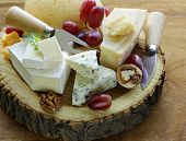 picture of brie cheese  - cheeseboard with assorted cheeses (parmesan, brie, blue, cheddar)