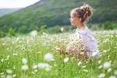 stock photo of preteen  - 7 years old child having fun in flower field - JPG