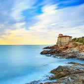 foto of leghorn  - Boccale castle landmark on cliff rock and sea on sunset - JPG