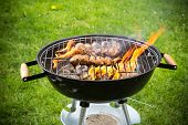 foto of braai  - Grilled chicken Legs on the grill - JPG