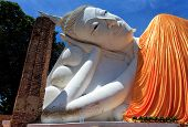 stock photo of recliner  - The white reclining Buddha with blue sky - JPG
