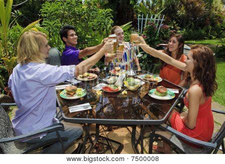 friends at a backyard bar-b-que