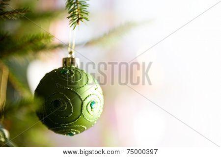 Beautiful christmas decorations hanging on christmas tree