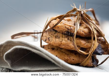Pile of delicious chocolate chip cookies on table