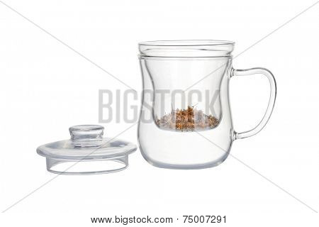 Preparation of the chamomile tea. Tea infuser with dry chamomile flowers isolated on white.