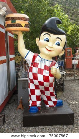 CIBOLA COUNTY, NEW MEXICO - OCTOBER 6, 2014: Bob's Big Boy mascot statue in an antique store in Cibola County, New Mexico. Bob's Big Boy is a restaurant chain founded in Southern California in 1936.
