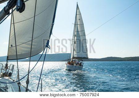 ERMIONI - POROS, GREECE - OCT 9, 2014: Unidentified sailboats participate  in sailing regatta