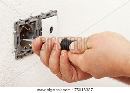 Electrician Hand Mounting A Wall Fixture