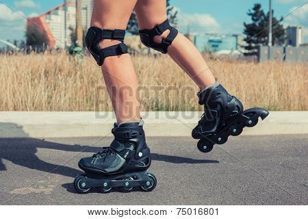 Woman Rollerblading On Sunny Day