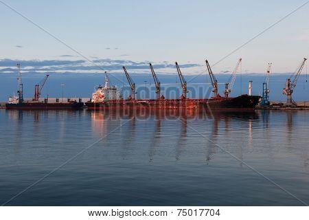 Cargo terminal. Cargo ship in port.