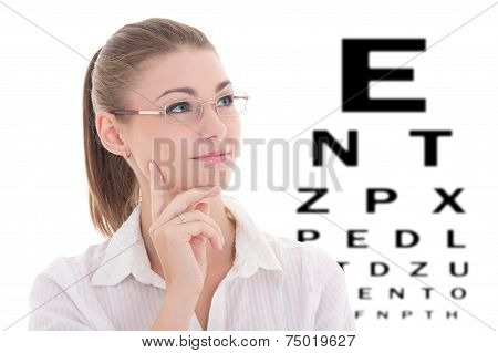 Portrait Of Young Beautiful Business Woman In Glasses And Eye Test Chart Isolated On White