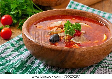 Soup solyanka Russian with meat, olives and gherkins