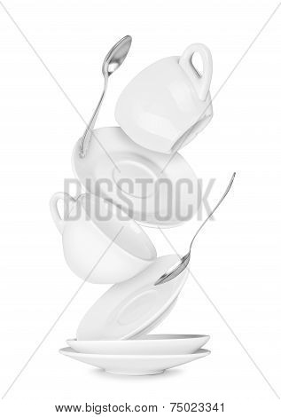 Falling Coffee Cup And Saucer On The Isolated White Background
