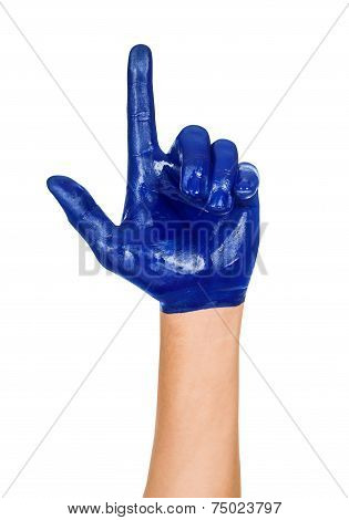 Hand With A Raised Index Finger, Painted In Blue Paint Isolated On White Background