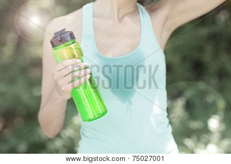 Young woman after long run at park