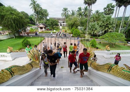 Luang Prabang, Laos - August 10 : Tourists Going Up To Worship In Haw Pra Bang On August 10, 2014 In