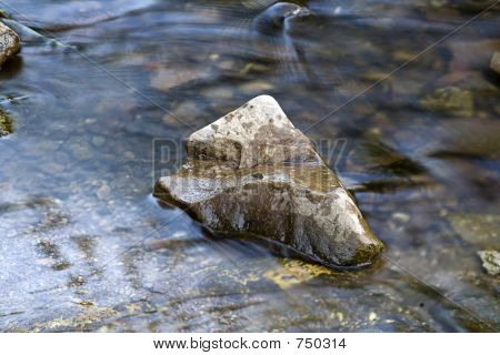 river flowing over a rock