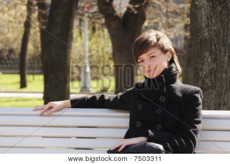 Serene Woman In Black On Bench