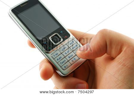 Dialing a mobile phone on a white background