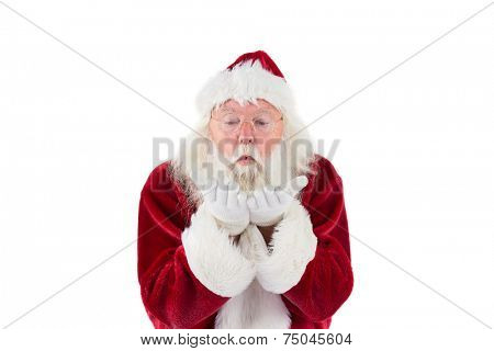 Santa Claus blows something away on white background