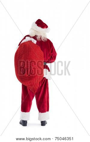 Santa carries his bag away on white background