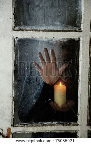 Mystic photo of female hand on  dirty old glass
