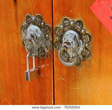 Ancient knockers and modern lock closeup