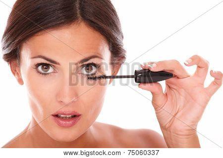 Afraid Woman With Brown Eyes Applying Mascara