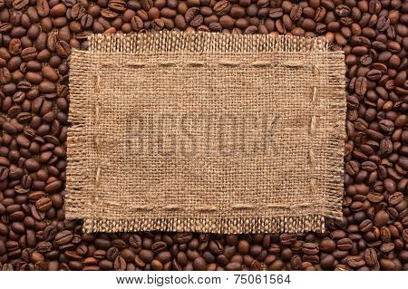 Frame Of Burlap And Coffee Beans Lying On A White Background