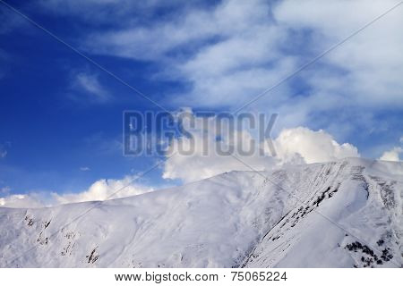Off-piste Slope At Evening And Sky With Clouds