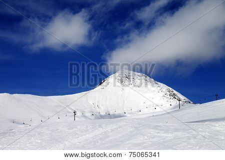 Chair-lift And Ski Slope At Sun Wind Day