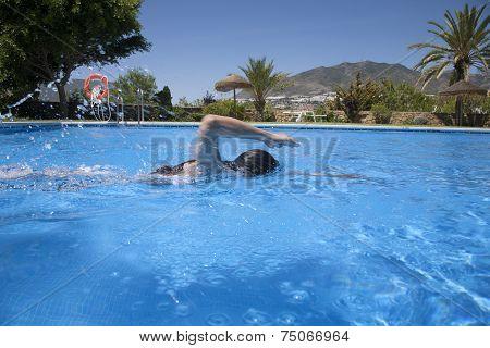 Woman Swimming Crawl In A Pool