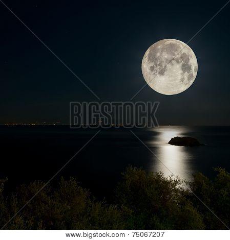 Full Moon And Moonlight On Night Sea
