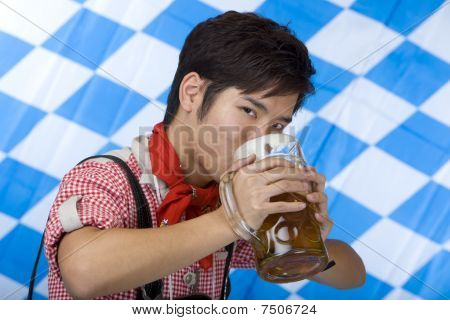 Asian Boy Drinking Aout Of An Oktoberfest Beer Stein (mass)