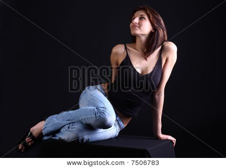 Girl Lies At Dark Background