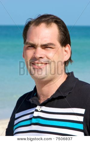 Casual Dark Haired Man At Beach